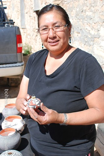 an artisan and her work at Acoma Pueblo Sky City