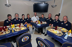 Four parent-child pairs of crew members deployed in support of Pacific Partnership pose for a picture during a breakfast with Reserve Deputy Commander and Chief of Staff, U.S. Pacific Fleet, Rear Adm. Russell S. Penniman. (U.S. Navy Photo by Mass Communication Specialist 2nd Class Stephen M. Votaw)