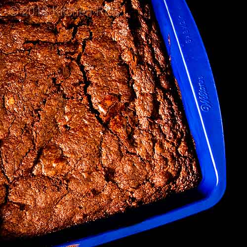 Ultimate Chocolate Brownies in Baking Pan, Overhead View with Black Background