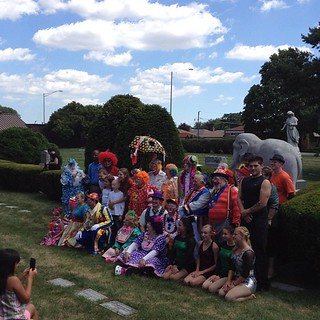 A bunch of clowns at a cemetery