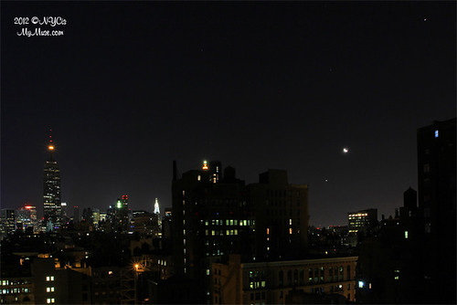 As the Empire State Building sleeps, Venus, the moon and Jupiter align