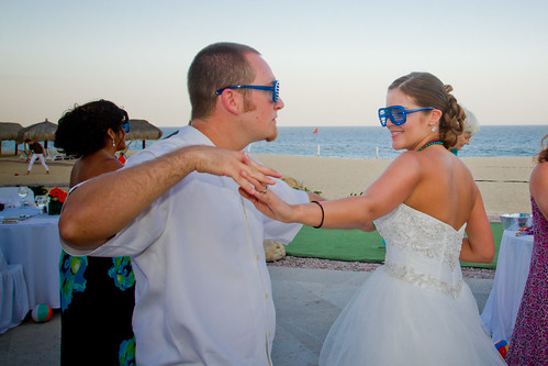 bride and groom dancing with shutter shades on