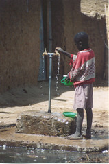 Nigeria boy at water pump