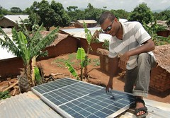 Numfor Jude installs solar panels in the small agrarian village of Sabongari, in Cameroon's North West Region. Credit: Monde Kingsley Nfor/IPS