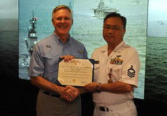 YOKOSUKA, Japan (July 16, 2012) Secretary of the Navy Ray Mabus, left, awards the Meritorious Service Medal to Japan Maritime Self-Defense Force Command Master Chief Takenori Shimoyuse, the fleet command master chief for the Self-Defense Fleet, aboard U.S 7th Fleet flagship USS Blue Ridge (LCC 19) during to an award ceremony. (U.S. Navy photo by Mass Communication Specialist 2nd Mel Orr)