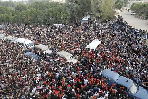 Egyptian military police, wearing red berets, were seen among mourners Tuesday as the convoy carrying the casket of Pope Shenuda III, the spiritual leader of the Middle East's largest Christian Church based in Egypt. by Pan-African News Wire File Photos