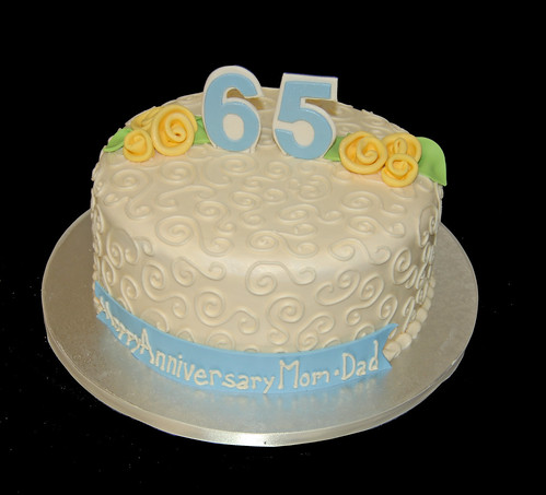 cream and yellow 65th wedding anniversary cake