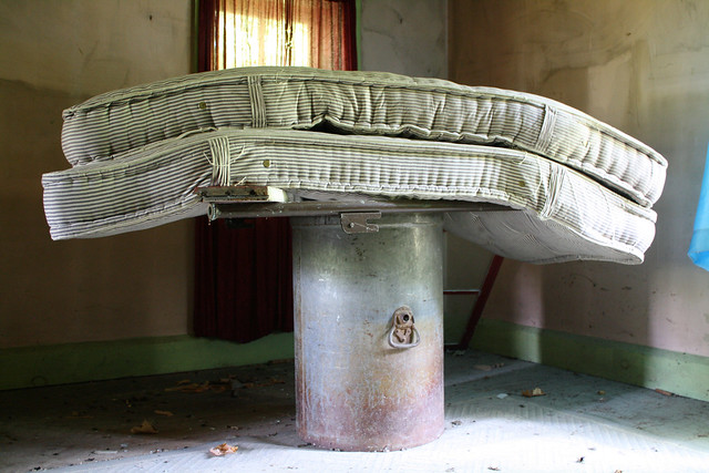The mattresses perform a balancing act atop a metal drum.