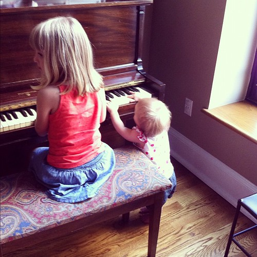 Piano sisters. (My sister's apartment is so not kid-proofed.)
