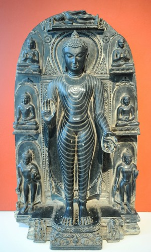 Lord Buddha surrounded by figures depicting aspects of his life story, enlightenment, and his death (parinirvana), mudra of giving, carved black stone, Art Institute of Chicago, Illinois, USA by Wonderlane