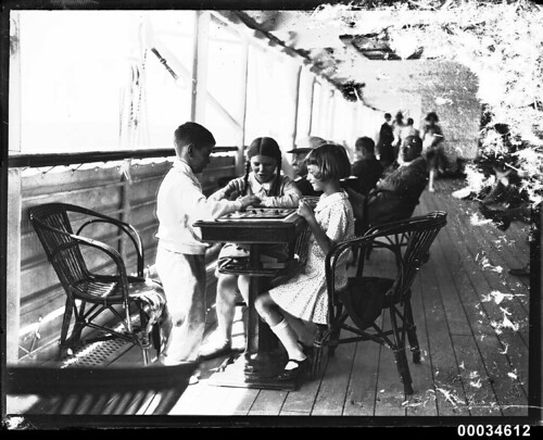 Three children playing a board game possibly on SS ORMISTON, 1927-1939