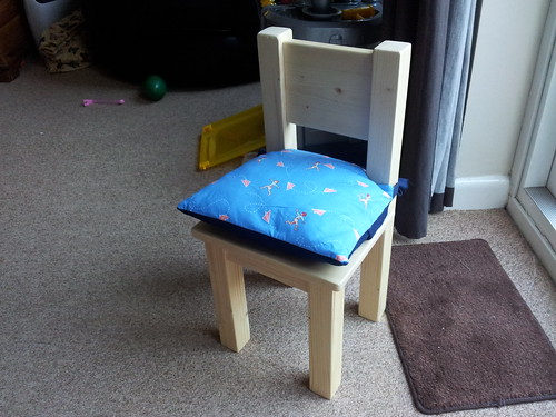 Finished chair and booster cushion