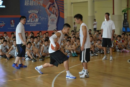August 19th, 2012 - Jeremy Lin instructsa a basketball camp attendee during the first day of his basketball camp in Dongguan