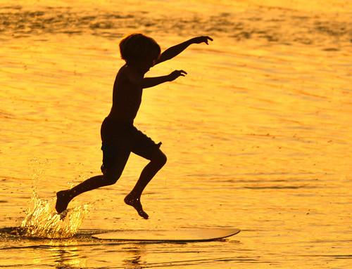 summer beach silhouette golden colorful child play surfing pacificocean shore splash laplaya delmar sandiegocounty
