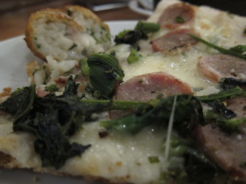 Pizza with sweet sausage, broccoli rabe, roasted garlic & mozzarella