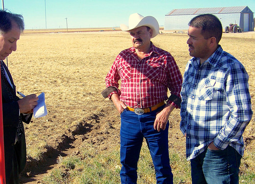 Under Secretary Ed Avalos (left) listens to Carlos and Greg Chavez explain the ongoing effects of drought on farms in Texas. Greg, a next generation farmer, has worked to increase the sustainability and success of his family farm by implementing new technology and irrigation methods that decrease water consumption.