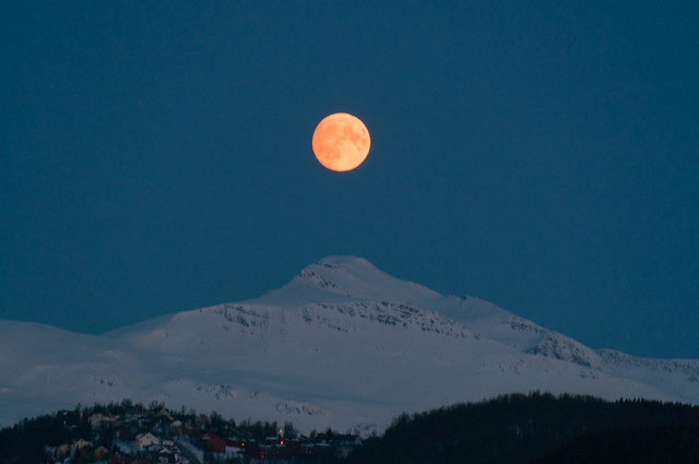 Orange moon over Tromsø mountains