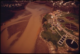 Aerial View Of The Occoquan Water Filtration Plant And The Occoquan River Muddied From Siltation And Soil Erosion, April 1973