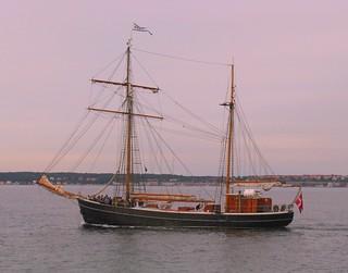 Danish sailboat in the waters of Øresund, the strait between Denmark and Sweden, near Helsingør (DK) and Helsingborg (SE)