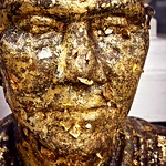 "E Wechter_MonkStatue -- ""Gold Leaf Monk"" by Emily Wechter (AsiaLearn Thailand) Category: Celebration This is a statue of a famous Buddhist monk at a Buddhist temple. In order to show their respect, Thai people will come to the temple to purchase a gold leaf. They will then make a wish and stick the gold leaf on the statue. — at Ayuttaya, India."