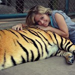 "E Wechter_Tiger -- ""Tiger Temple"" by Emily Wechter (AsiaLearn Thailand) Category: Nature/Landscape This was taken at the Tiger Temple in Chiang Mai, Thailand. Here, they raise tigers and allow visitors to play with and feed them. The tigers are extremely playful and will even fetch sticks for you. — at Chiang Mai, Thailand."