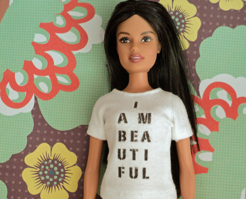 Mattel Rebeldes doll in I Am Beautiful shirt