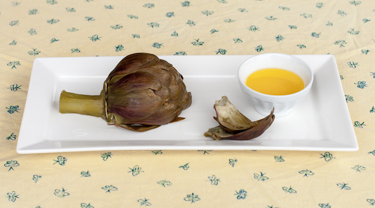 Pressure cooked artichoke served simply with melted butter