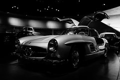 single lens reflex camera(0.0), race car(1.0), automobile(1.0), vehicle(1.0), performance car(1.0), automotive design(1.0), mercedes-benz(1.0), monochrome photography(1.0), mercedes-benz 300sl(1.0), antique car(1.0), vintage car(1.0), land vehicle(1.0), monochrome(1.0), black-and-white(1.0), supercar(1.0), sports car(1.0), classic(1.0),