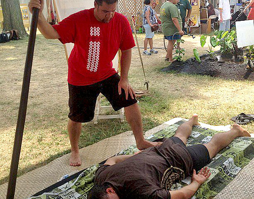 <p>Lomi lomi demonstration at the University of Hawaii tent at the Smithsonian Folklife Festival.</p>