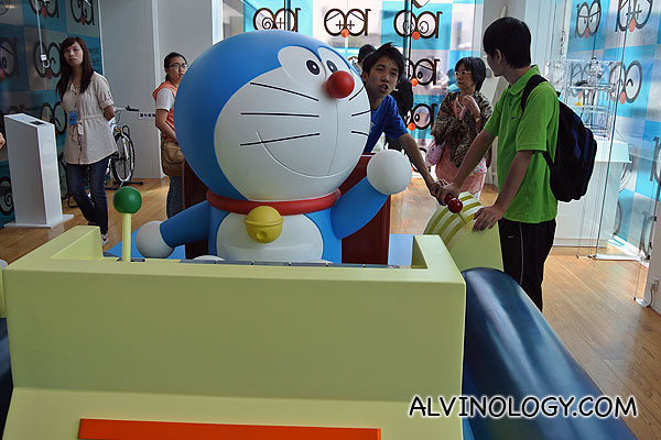 A large Doraemon figurine in the centre of the room