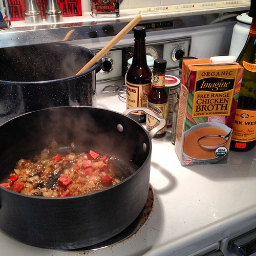 Transfer to stockpots (making some for our dinner tonight, too), add a little wine and chicken broth. Then fill pots with water.