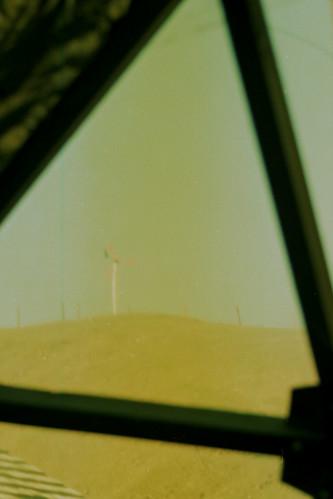 windmill scannedfilmnegative charliewambekephotography nikonfe2photo personalelectricgeneratingwindmillin1976 windmillonahill windmillseenfrominsidethehouseitserviced