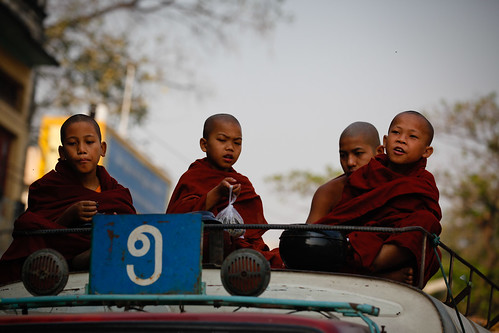Novice monks atop a bus