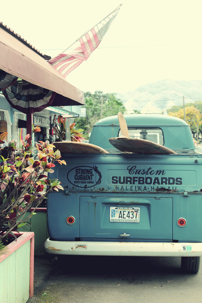 surfboards and vintage cars