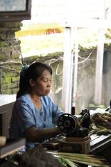 Sewing batik fabric.