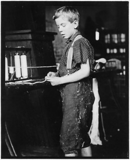 Youngster making bands, cotton mill. Clarence Noel, 11 years old. North Pownal, Vt, August 1910