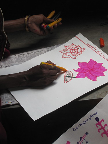 Rose (left) and lotus flower (right). The lotus flower is the national flower of India.