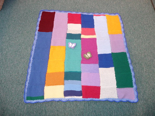 A blanket full of Knitted squares.