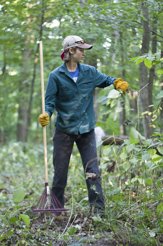 Julia Sievert '12 works to clean a trail on Tuesday, Aug. 7. Sievert is one of three summer stewards at Green Oaks this year. Photo by John Williams