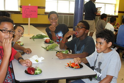 Fruit and Veggie Ambassadors sampling fresh fruit and vegetables at a Pawtucket Summer Food Service Program.
