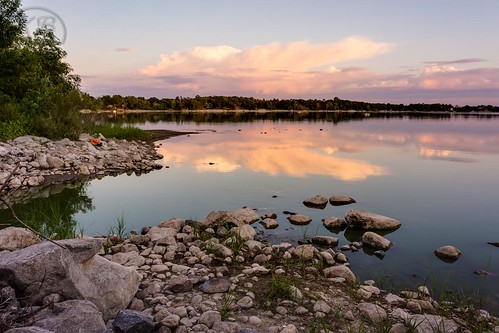 trees sunset lake reflection wet water weather minnesota rock clouds landscape evening still rocks flickr shoreline peaceful calm fluid granite swanlake liquid distant facebook cumulonimbus bolders clearskies