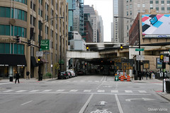 Traffic sign ahead tells people to use LaSalle or Clark
