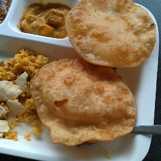 Freshly fried puris at lunchtime