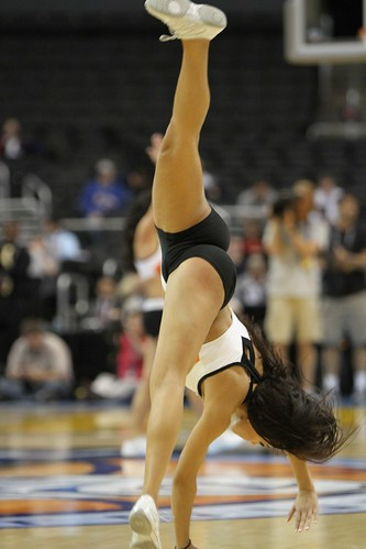 Cheerleader Cartwheel by TheDailySportsHerald