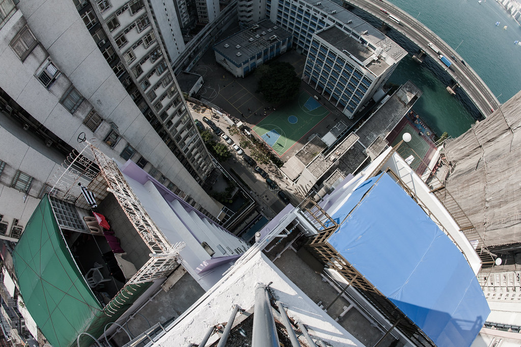 vertigo shot looking downon a basketball court in hong kong from a rooftop