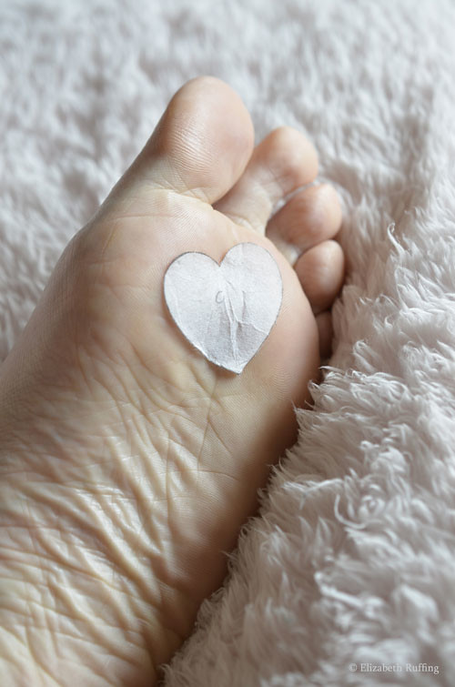 Elizabeth Ruffing's foot with a paper heart stuck on the bottom