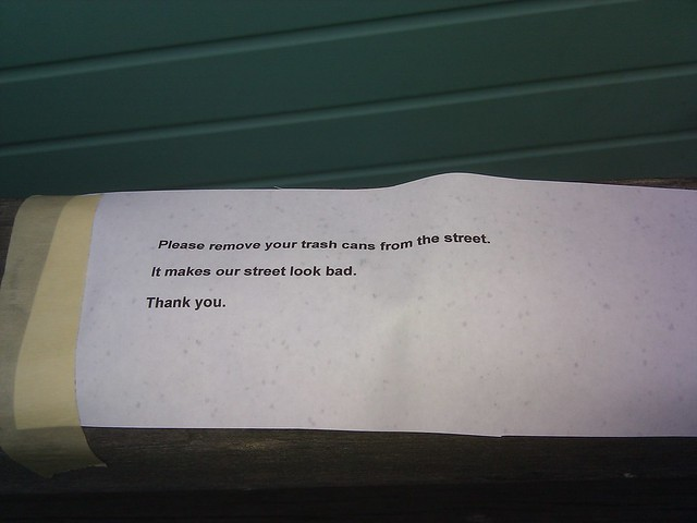 "nothing says ""i love my neighborhood"" like taping passive-aggressive anonymous notes to your neighbors's houses."