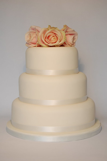 Ivory 3 Tier Round Wedding Cake With Fresh Roses