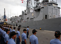 GENERAL SANTOS CITY, Philippines (July 1, 2012) Philippine navy sailors stand at attention to welcome the U.S. Navy as the USS Vandegrift (FFG 48) arrives for Cooperation Afloat Readiness and Training (CARAT). (U.S. Navy photo by Mass Communication Specialist 1st Class Stephen Hickok)