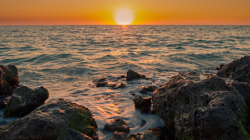 orange sun gulfofmexico nature water yellow catchycolors rocks waves seascapes sunsets 100v10f beaches sunburst skyscapes gf1 fav10 beachphotography cloudsstormssunsetssunrises sunsetmadness sunsetsniper caspersensbeach
